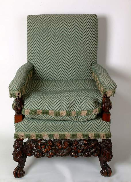 F5. Upholstered armchair